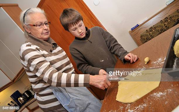 grand mother and grandson are baking Chritmas cookies
