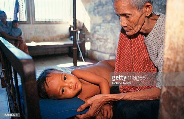 Grand mother looks after her sick child in the provincial hospital of Kampot. .