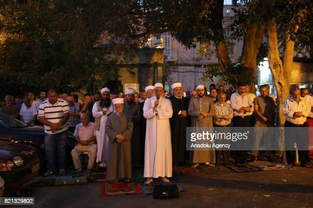 Grand Mufti of Jerusalem Muhammad Ahmad Hussein performs the evening prayer with Palestinians in front of the Lion's Gate at Al Aqsa Mosque refusing...