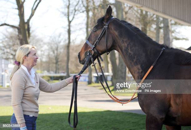 Grand National winner Auroras Encore is led by his trainer Sue Smith outside the stables ahead of the Scottish Grand National tomorrow during day one...