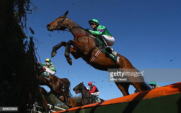 Grand National winner Mon Mome with jockey Liam Treadwell jump the open ditch during the John Smiths Grand National at Aintree racecourse on April 4...