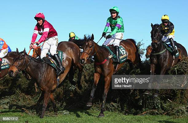 Grand National winner Mon Mome with jockey Liam Treadwell jump the open ditch during the John Smiths Grand National at Aintree racecourse on April 4,...