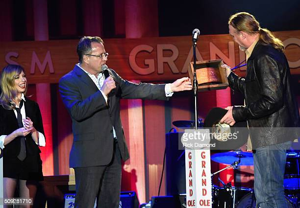 Grand Ole Opry Pete Fisher makes presentation to Grand Ole Opry member Trace Adkins during Grand Ole Opry at CRS Day 1 at Omni Hotel on February 8...