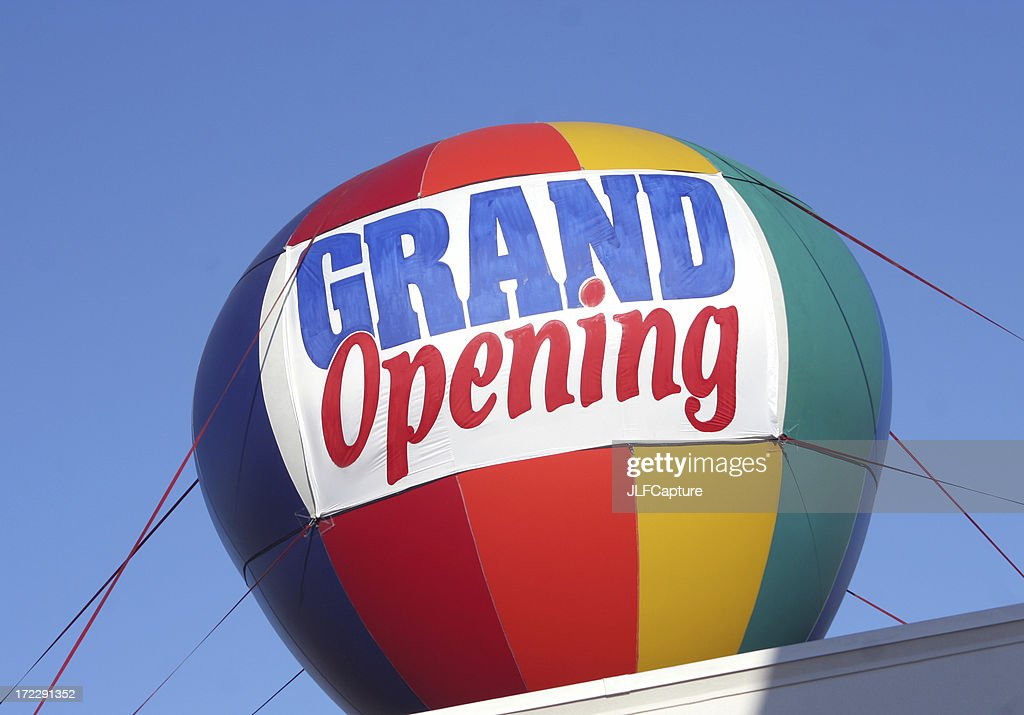 Grand Opening Sign - colorful hot air balloon : Stock Photo