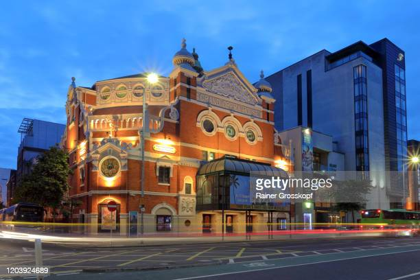 grand opera of belfast illuminated at dusk with light trails of passing traffic - rainer grosskopf stock pictures, royalty-free photos & images