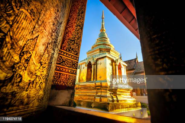 grand pagoda of wat phra singh tenple, wat phra singh is one of the most famous landmark of chaingmai, thailand - wat stock pictures, royalty-free photos & images