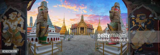 Grand palace and Wat phra keaw have Giant statue at Temple on sunset . Wat Phra Kaew is one of Bangkok's most famous tourist in Bangkok , Thailand