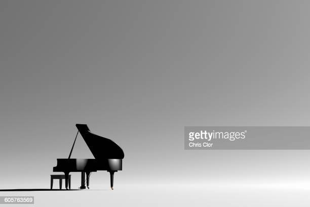 grand piano and bench in empty room - grand piano stock photos and pictures
