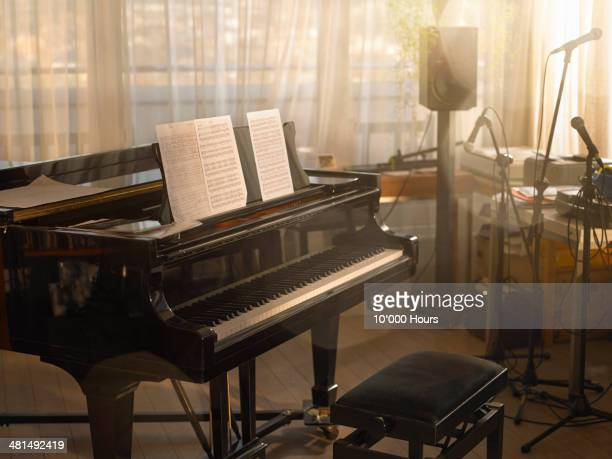 grand piano in a music room - piano stock pictures, royalty-free photos & images