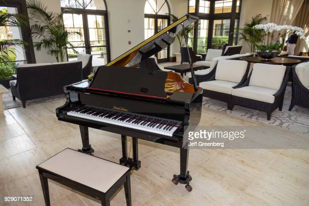 A grand piano inside the lobby at The Alfond Inn
