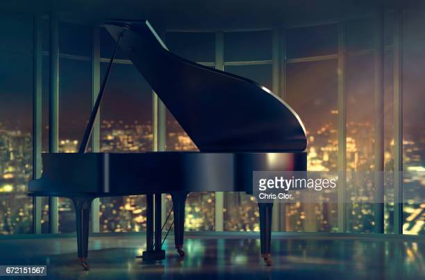 grand piano near window with scenic view of city - grand piano stock photos and pictures