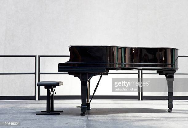 grand piano on stage - grand piano stock photos and pictures
