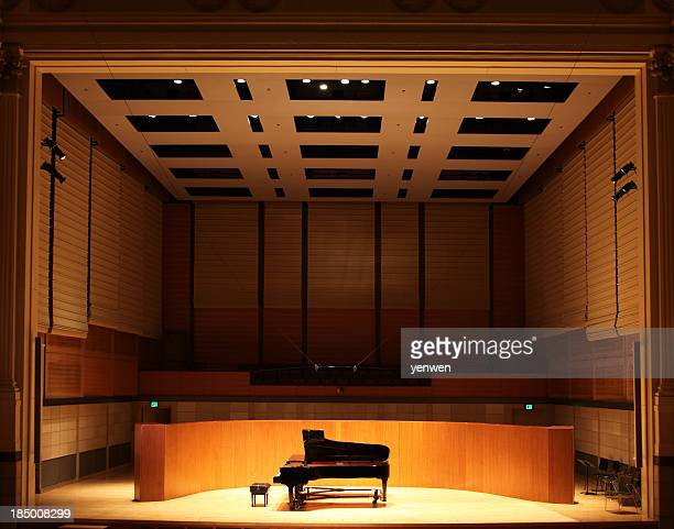 grand piano on stage - concert hall stock pictures, royalty-free photos & images