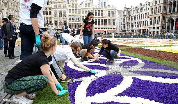 Grand Place square of Brussels is turned into a giant Japanese-themed carpet by people, made up of 600,000 begonias and dahlia flowers, in Brussels,...