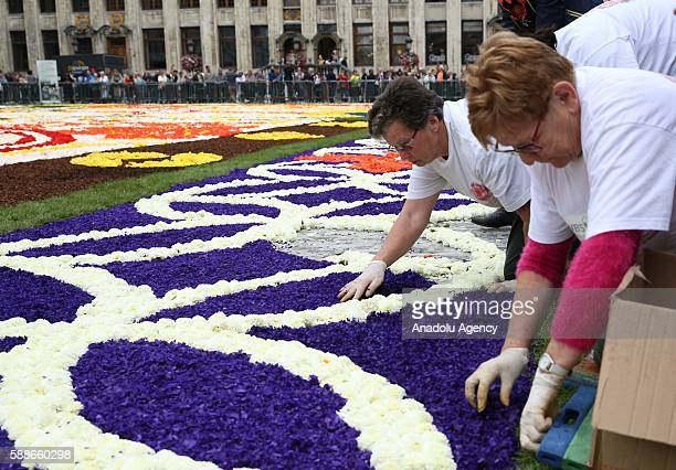 Grand Place square of Brussels is turned into a giant Japanesethemed carpet by people made up of 600000 begonias and dahlia flowers in Brussels...