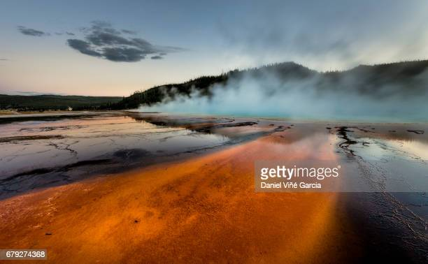 grand prismatic spring at sunset, midway geyser basin, yellowstone national park. - smoke physical structure stock pictures, royalty-free photos & images