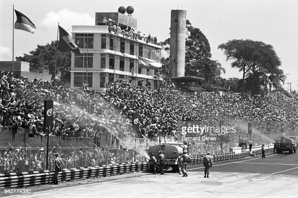 Grand Prix of Brazil, Interlagos, Sao Paulo, 26 January 1975. Brazilian fans beingcooled down by the fire brigade during the 1975 Brazilian Grand...