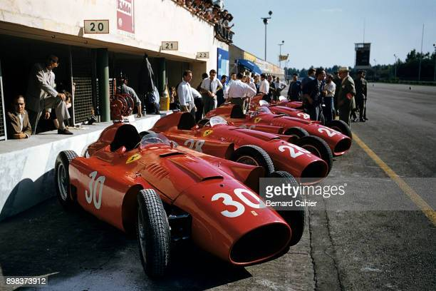 Grand Prix of Italy, Autodromo Nazionale Monza, 02 September 1956. Ferrari squad in the Monza pits during the 1956 Italian Grand Prix.