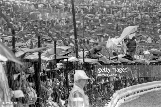 Grand Prix of Japan Fuji Speedway 24 October 1976 Japanese fans patiently waiting under pouring rain during the 1976 Japanese Grand Prix