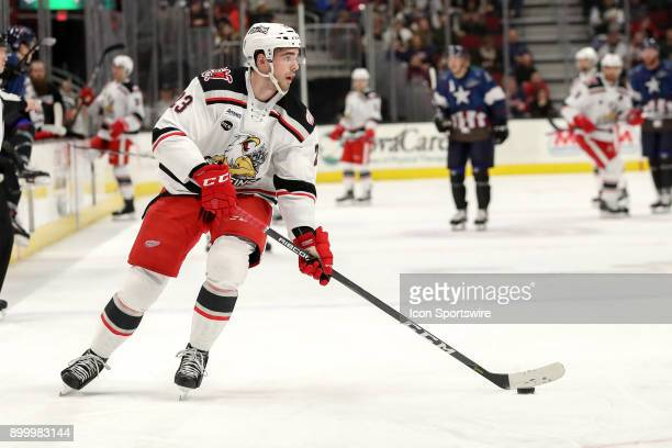 Grand Rapids Griffins center Dominic Turgeon controls the puck during the first period of the American Hockey League game between the Grand Rapids...