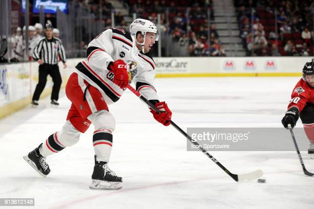 Grand Rapids Griffins center Dominic Turgeon passes the puck during the first period of the American Hockey League game between the Grand Rapids...