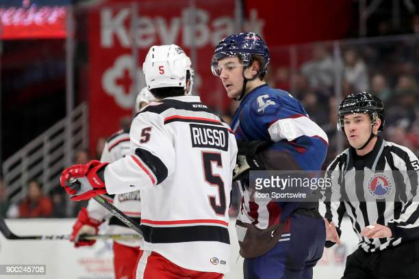 Grand Rapids Griffins defenceman Robbie Russo and Cleveland Monsters right wing Hayden Hodgson exchange words during the second period of the...