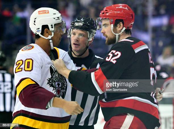 Grand Rapids Griffins defenseman Dylan McIlrath and Chicago Wolves right wing Keegan Kolesar fight during the game between the Chicago Wolves and the...