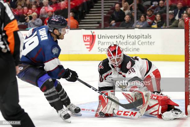 Grand Rapids Griffins goalie Tom McCollum stops a point blank shot by Cleveland Monsters center Carter Camper during the second period of the...