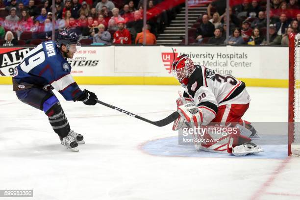 Grand Rapids Griffins goalie Tom McCollum uses his glove to stop a point blank shot by Cleveland Monsters center Carter Camper during the second...