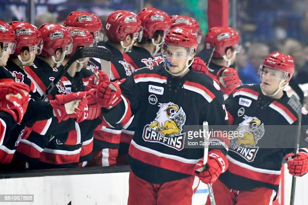 Grand Rapids Griffins Matt Puempel celebrates with teammates after the Gran Rapids Griffins scored a goal during the game between the Chicago Wolves...