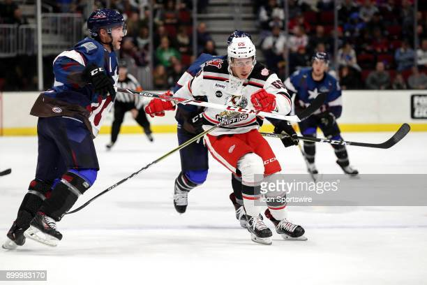 Grand Rapids Griffins right wing Dominik Shine passes Cleveland Monsters defenceman Andre Benoit as he follows the puck into the corner during the...