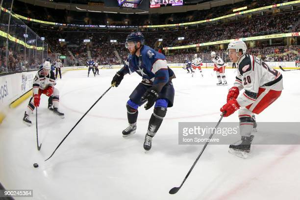 Grand Rapids Griffins right wing Evgeny Svechnikov Cleveland Monsters left wing Nick Moutrey and Grand Rapids Griffins defenceman Dan Renouf follow...