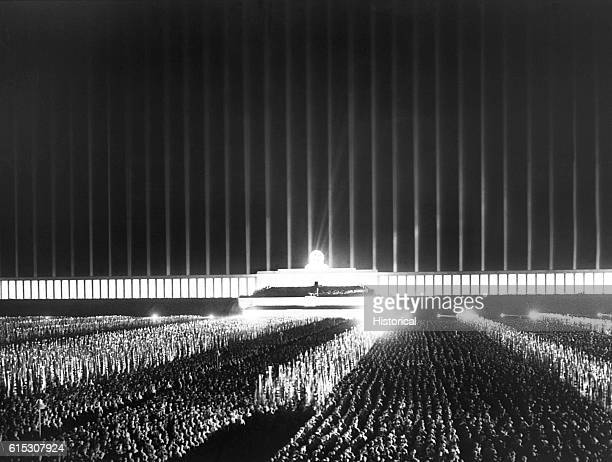 A grand review of party leaders fills the searchlightilluminated Zeppelin Field in Nuremberg during the Nazi Party rally of September 1937 | Location...