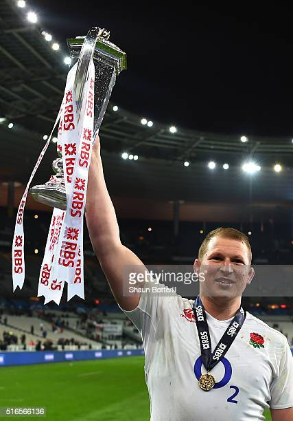 Grand Slam winning captain Dyan Hartley of England celebrates with the trophy following his team's 31-21 victory during the RBS Six Nations match...