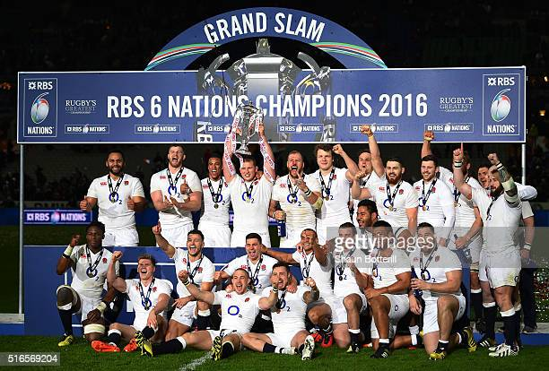 Grand Slam winning captain Dyan Hartley of England lifts the trophy following his team's 3121 victory during the RBS Six Nations match between France...