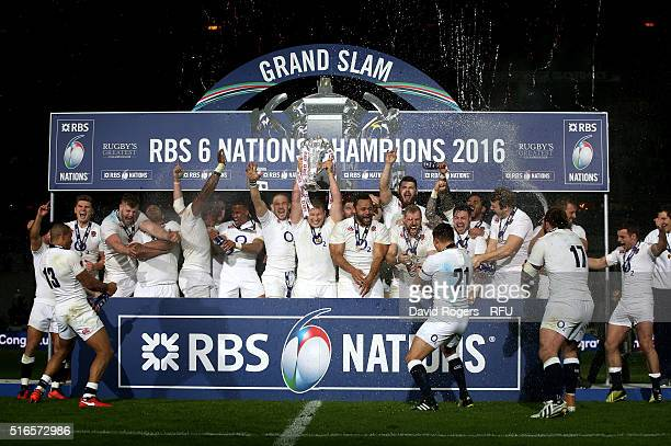Grand Slam winning captain Dyan Hartley of England lifts the trophy following his team's 31-21 victory during the RBS Six Nations match between...