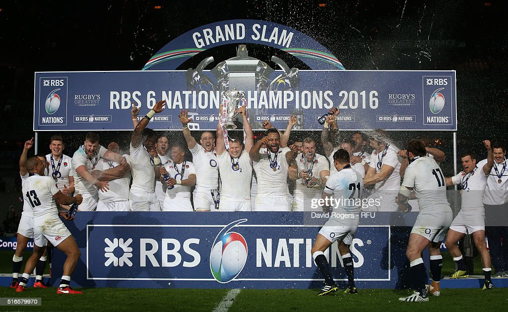 Grand Slam winning captain Dyan Hartley of England lifts the trophy following his team's 31-21 victory during the RBS Six Nations match between France and England at the Stade de France on March 19, 2016 in Paris, France.