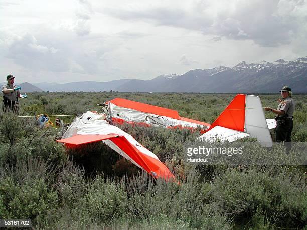 Grand Teton National Park rangers examine the debris from an ultralight aircraft crash that killed Jackson Hole Wyoming resident John Walton on June...
