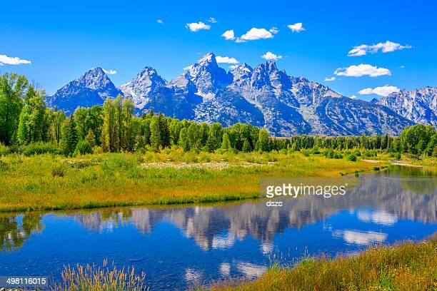grand tetons mountains, summer, blue sky, water, reflections, snake river - jackson hole stock pictures, royalty-free photos & images