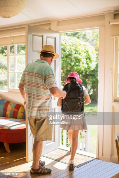 Grandad taking his granddaughter to school