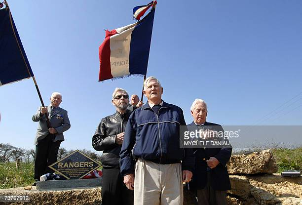 Three American veterans Jim Gabaree Jack Burke and Daniel Farley who took part in the liberation of Paris 09 June 1944 wave in front of tablets after...