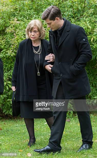 Grandchild JulienChristopher Fuchsberger and widow Gundula 'Gundel' Fuchsberger go to the commemoration for decedent Joachim Fuchsberger on September...