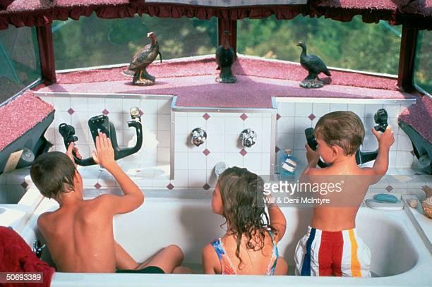 Grandchildren of beautician Jo Ann Ussery Steven Katelyn Morgan taking bath in former cockpit/bathroom at her homewhich is converted Boeing 727...