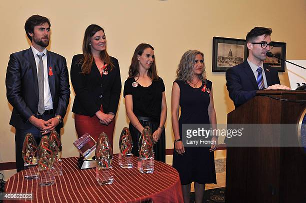 Grandchildren of Elizabeth Taylor Tarquin Wilding Eliza Carson Naomi deLuce Wilding and Laela Wilding listen to Quinn Tivey speak at the the...