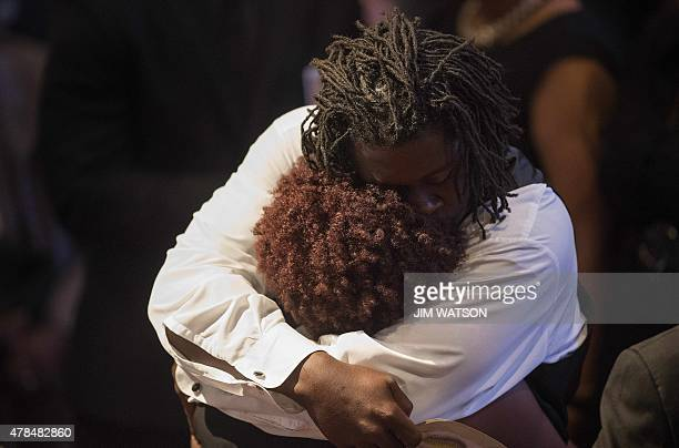 Grandchildren of Emanuel AME Church shooting victim Ethel Lance hug after delivering remarks at her funeral at the Royal Missionary Baptist Church in...