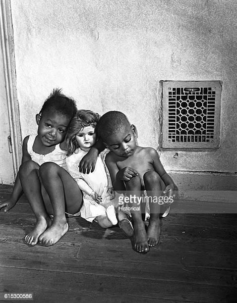 Grandchildren of Mrs Ella Watson a US government charwoman Washington DC August 1942