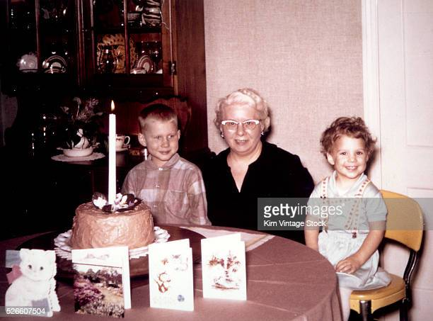 Grandchildren with grandma at birthday party ca 1964
