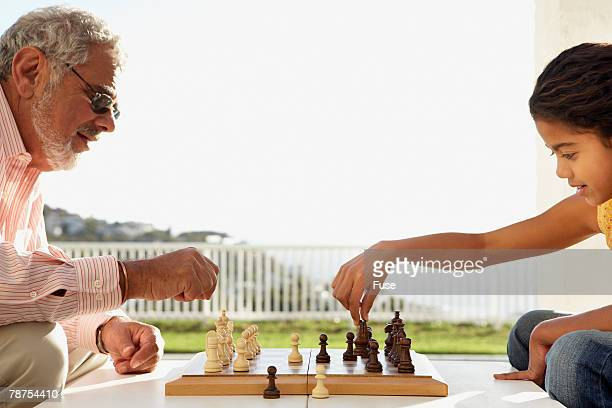 Granddaughter and Grandfather Playing Chess