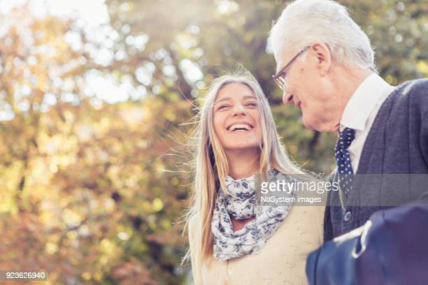granddaughter and grandfather walking in the park - dementia stock pictures, royalty-free photos & images