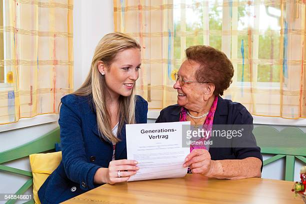 granddaughter and grandmother with contract of the generations